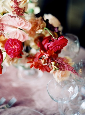 Wedding reception centerpiece design pink flowers amaranthus anthurium leaves flowers blossoms ivory