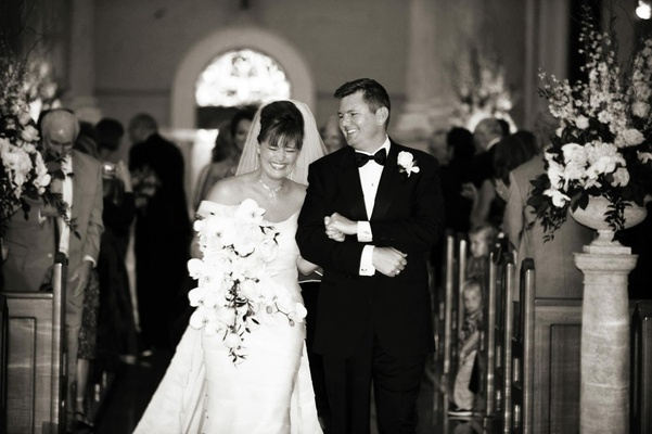 Black and white photo of bride and groom smiling
