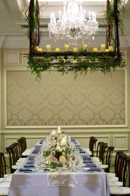 Silver Tablecloths With Lace Runners And Short Florals