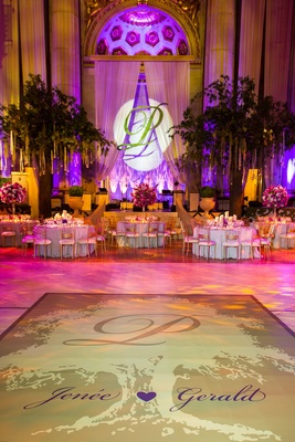 Ballroom reception space with tree and wedding names