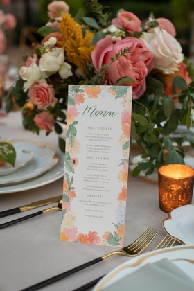 menu card for wedding reception dinner with floral border in pinks and oranges peachy hues