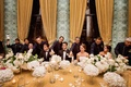 bride groom groomsmen and bridesmaids as the bridal party are served drinks on gold table linen