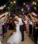 wedding sparkler exit purple lights on palm trees outdoor wedding florida bride groom kiss