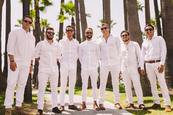 groom and groomsmen in all white, white dress shirt and white linen pants