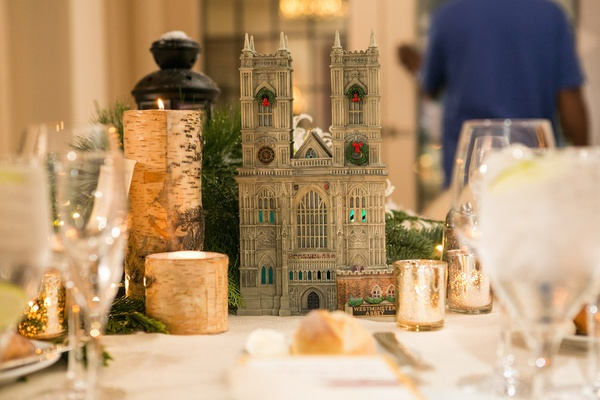 Holiday wedding reception table with Dickens' Village Series Westminster Abbey figurine