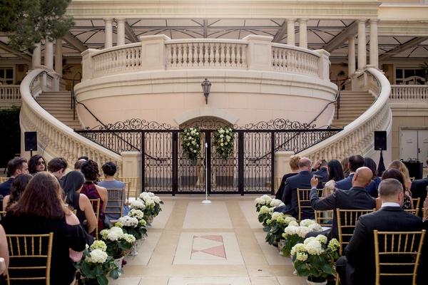 outdoor wedding ceremony at the bellagio hotel patio in las vegas
