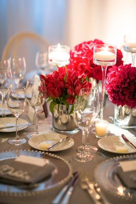 red bloom concept round table reception california wedding candles gray chargers
