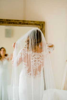 bride in pronovias wedding dress with lace illusion back, long veil