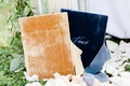 wedding ceremony vow books gold and navy blue velvet vows on aisle flower petals
