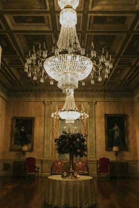 rosecliff mansion newport rhode island wedding reception chandelier flower arrangement silhouettes
