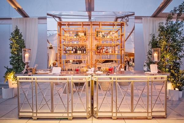 Cocktail hour bar with mirror bar side and top trees tented wedding ideas