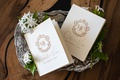 wedding vow books gold monogram calligraphy on silver tray stephanotis blossom flowers