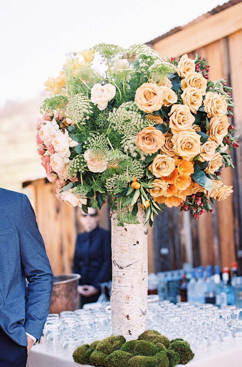 Birch tree centerpiece with gold roses