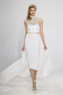 Christian Siriano for Kleinfeld Bridal crop top with jewel high neck cap sleeves mid-length skirt
