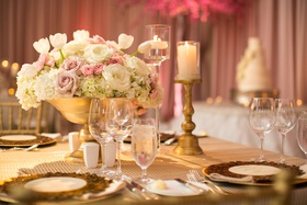 small wedding centerpiece in low golden bowl with blush and ivory flowers tulips, roses, hydrangeas