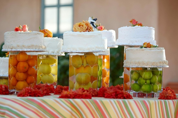 Citrus wedding cake stands on fruit pillars
