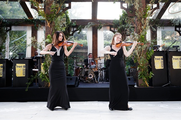 Tent wedding reception nature inspired decorations women in black gowns with violins on dance floor