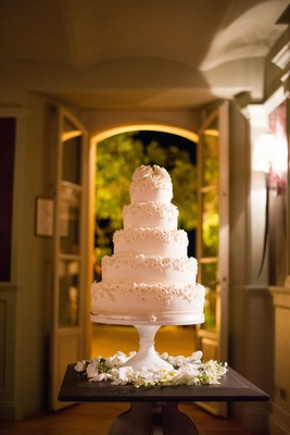 White wedding cake with small sugar flowers