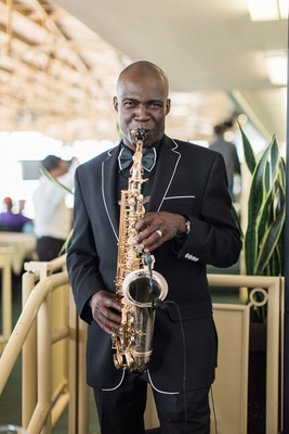 Wedding entertainment saxophone sax player at race track santa anita black suit with white piping