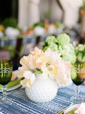 bridal shower decor blue white batik linen tablecloth greenery goblet colored glassware pink flowers