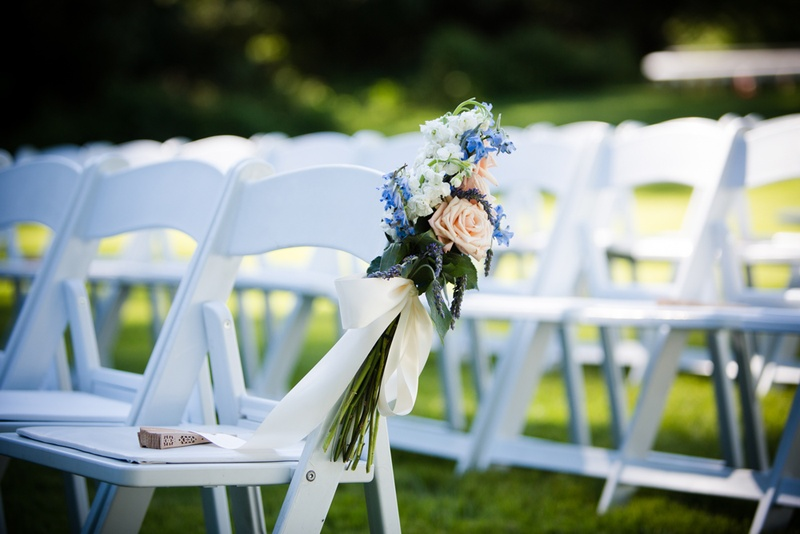 White Chairs At A Wedding Indoor Stock Photo: Blue And Peach Chair Flowers