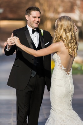 Josh and Allie smile at each other after their first look bride in Ines Di Santo dress groom in tux