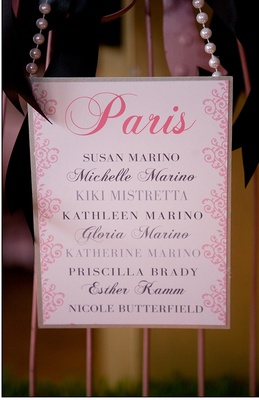 Pink place card with guest names