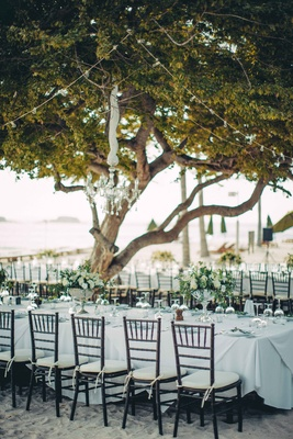 long tables chandeliers beach reception white greener tree punta mita mexico destination wedding