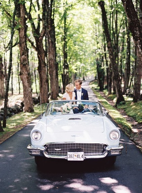 Classic baby blue historic vehicle on small road in forest for wedding portraits
