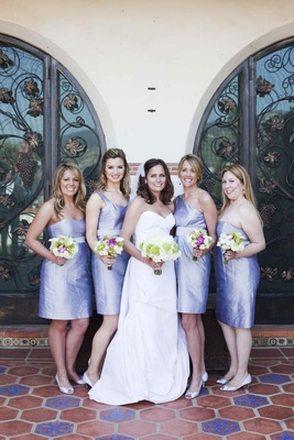 Short purple bridesmaid dresses and bouquets