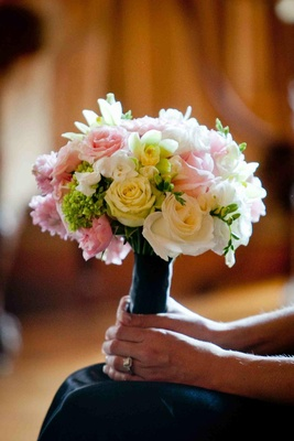 Bridesmaid's bouquet of light yellow, pink, and green flowers