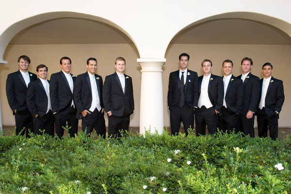 Groom with groomsmen in black suits and ties
