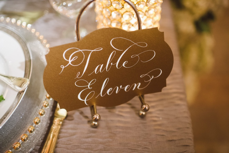 Art Deco-inspired table numbers on gold easels