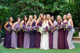 wedding portrait bride in marchesa wedding dress and bridesmaids in purple dresses matching bouquets