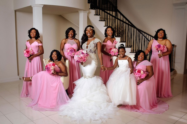 bridesmaids in mismatched bridesmaid dresses in light pink color one shoulder high neck