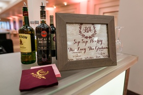 Wood sign at bar for wedding signature drinks custom personalized napkins