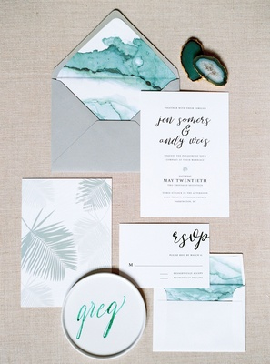 Grey envelope with teal envelope liner and invitation Minted with palm leaf print calligraphy