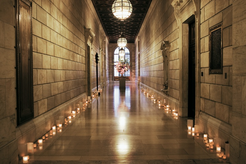 Stone hall illuminated by candles and lanterns