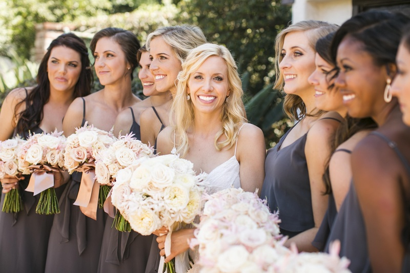 Bride with bridesmaids in dark grey dresses