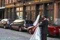 wedding couple kissing on street