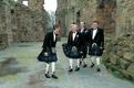 Groomsmen in traditional Scotland wedding attire with kilts