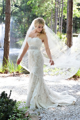 Bride in a strapless lace Anne Barge gown with beaded belt and veil