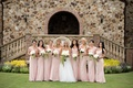 Bride with eight bridesmaids wearing light pink gowns