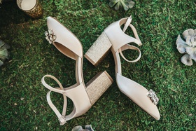 jewel by badgley mischka bridal shoes in gold glitter block heels and jewels at toe