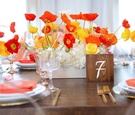 Wood table with square wood table number orange and yellow poppy flower centerpiece bridal shower