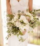 Amy Crawford holding bouquet of white and pink roses greenery freshly picked organic bouquet ideas