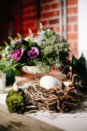 Wedding reception branch nest with egg and gold dinosaurs