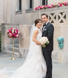 bride in monique lhuillier sleeveless mermaid wedding dress, groom in michael kors tuxedo