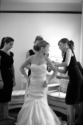 black and white bridesmaids help bride get ready