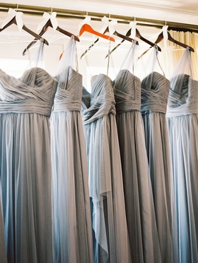 gray grey bridesmaids dresses on hangers waiting for the ceremony to begin